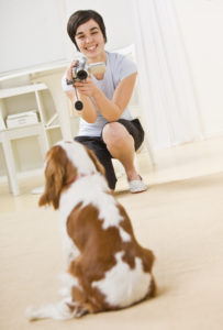 Woman Taking Picture of Dog